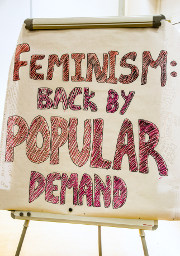 "Photo of the aforementioned decoration, ""Feminism: Back By Popular Demand"". The letters are hand-drawn in black and red marker pen."