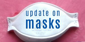 Update on masks (background is a photo of a shaped, disposable mask)